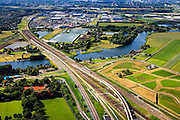 Nederland, Zuid-Holland, Barendrecht, 15-07-2012; spoorbruggen over de Waal, zijarm van de Oude Maas, gezien naar Barendrecht. De sporen van de HSL (links) buigen af richting Hoeksche Waard. Naar rechts de reguliere spoorlijn met fly-over en de Betuweroute richting Kijfhoek..Several railroads over the river Waal, Sout-West Netherlands, the HST, the regular and the freight railway crossing here..luchtfoto (toeslag), aerial photo (additional fee required).foto/photo Siebe Swart