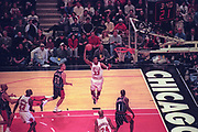 January 18, 1998, Chicago, Illinois, USA;  Scottie Pippen of the Chicago Bulls gets airborne for a dunk against the Houston Rockets at the United Center.  The Bulls defeated the Rockets 106-100.