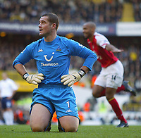 13/11/2004 - FA Barclays Premiership - Tottenham Hotspur v Arsenal - White Hart Lane<br />Tottenham's dejected Paul Robinson knees on the grass as Arsenal's Thierry Henry celebrates in the background<br />Photo:Jed Leicester/Back page images