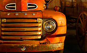 Fine Art:<br /> Old Red Ford Pick-up Truck parked next to an old west wagon in Georgia, USA. Limited Edition: