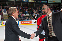 KELOWNA, CANADA - APRIL 14: Portland Winterhawks' head coach shakes hands with Kelowna Rockets' assistant coach Kris Mallette on April 14, 2017 at Prospera Place in Kelowna, British Columbia, Canada.  (Photo by Marissa Baecker/Shoot the Breeze)  *** Local Caption ***