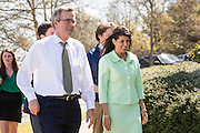 Former Florida Governor and GOP presidential candidate Jeb Bush walks with South Carolina Governor Nikki Haley during a visit to Sistercare March 17 29, 2015 in Columbia, South Carolina. Bush joined Haley in visiting the center for victims of domestic violence.