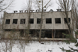 December 22, 2016 - Kiev, Ukraine - The abandoned building of restaurant in the deserted town of Pripyat,two kilometers from the Chernobyl nuclear power plant, Ukraine, on 22 December,2016. The explosion of Unit four of the Chernobyl nuclear power plant on 26 April 1986 is still regarded the biggest accident of nuclear power generation  in the history. (Credit Image: © Serg Glovny via ZUMA Wire)