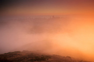 Morning fog at sunrise (downtown in distance) from Twin Peaks, San Francisco, California