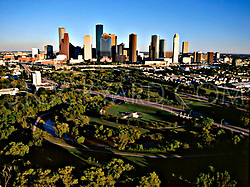 Aerial view of the Houston, Texas skyline from the west featuring the Hike & Bike Trail at Buffalo Bayou Park.