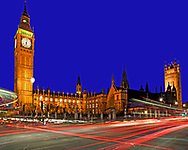 This is a great a low light image of the Parliament buildings at Westminster Abbey in London. It shows us the busy and corrupt world of power mixed with the street life of ordinary people outside. The deep blue sky frames this historic sandstone Victorian building with the bright white and red lights rushing passed. <br /> <br /> This night time photograph shows the fast pace of politics and London life from the blurring of lights caused by the traffic speeding in front of the camera.