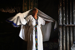 Elsa Haile, 20, prepares for church in her home in Bahir Dar, Ethiopia on May 27 2007. At age 11, Elsa ran away from home the day she was supposed to get married to a neighboring villager. She was later offered a job in a restaurant, but it turned out to be a brothel. Elsa does not know who fathered her daughter and has yet decided to test herself or her child for HIV, but she hopes to someday escape from nightmare her life has become.