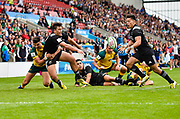 New Zealand fly-half Stephen Perofeta breaks a tackle and off-loads to New Zealand centre Patelesio Tomkinson during the World Rugby U20 Championship 5rd Place play-off  match Australia U20 -V- New Zealand U20 at The AJ Bell Stadium, Salford, Greater Manchester, England on Saturday, June  25  2016.(Steve Flynn/Image of Sport)