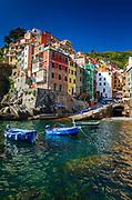 Colorful houses and boats in the harbor, Riomaggiore, Cinque Terre, Liguria, Italy