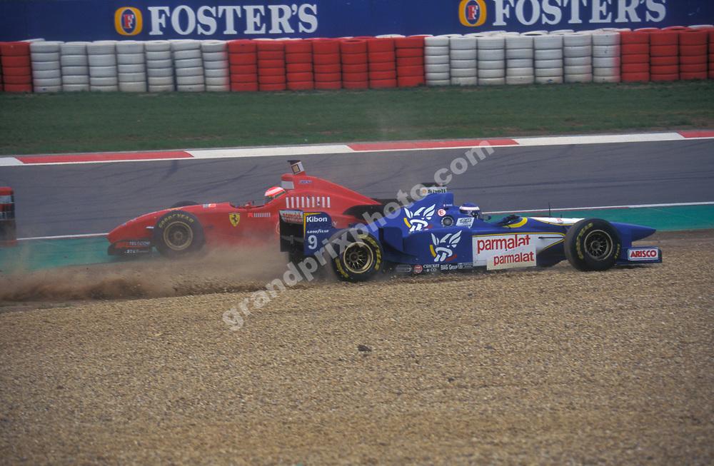 Olivier Panis (Ligier Mugen-Honda) goes into the gravel trap tp avoid the spinning Eddie Irvine (Ferrari) in the 1996 European Grand Prix at the Nurburgring.