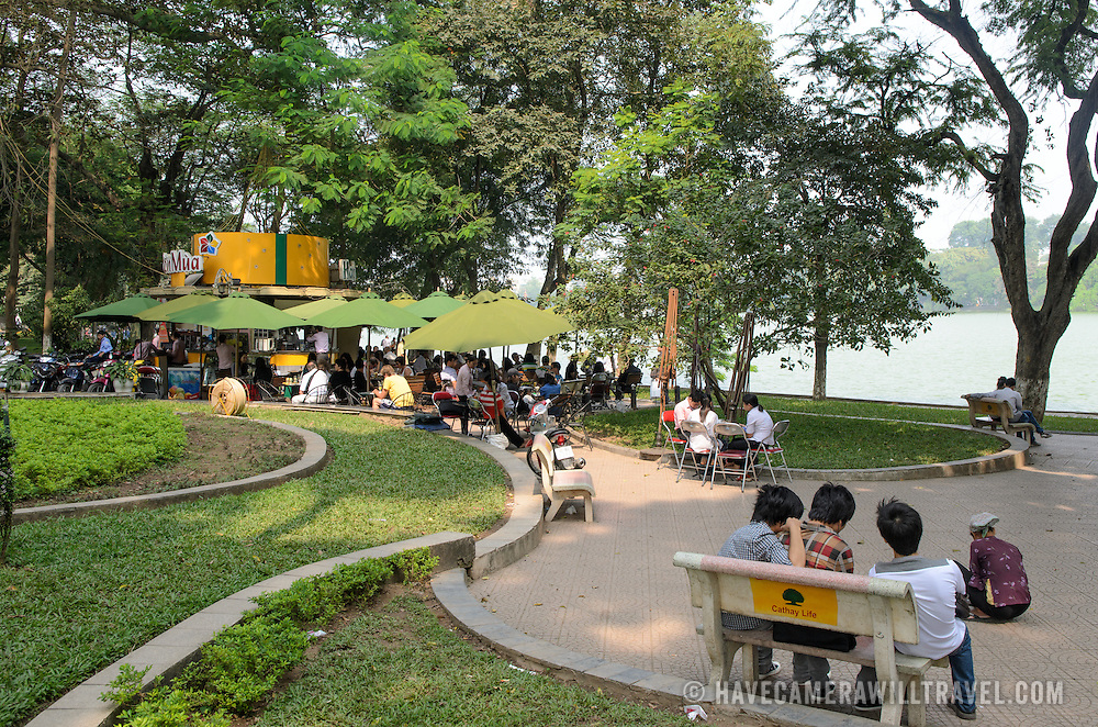 Locals congregate around a small cafe on the eastern shore of Hoan Kiem Lake in Hanoi, Vietnam.