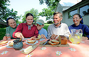 Amish family breaks bread for lunch.