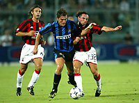 Ancona 12/08/2003<br />Trofeo Tim - Tim Cup <br />Christian Vieri (Inter) challenged by Cristian Brocchi (Milan right) and  Andrea Pirlo (Milan left)