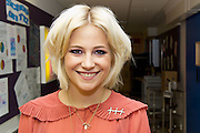 Singer Pixie Lott (wearing her TCT broach) visits the Teenage cancer Trust unit at UCLH (University College London Hospital) in Euston Road, London, 25 October 2011. For more info see www.teenagecancertrust.org. © Guy Bell Photography, GBPhotos