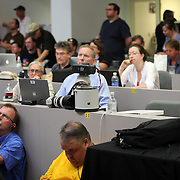 Members of the press write stories while watching the actual images of the shuttle in flight in the media press site at the Kennedy Space Center Friday, July 8, 2011, in Cape Canaveral, Fla. Over 1500 members of the press were credentialed to view the STS-135 launch on Friday. (AP Photo/Alex Menendez)