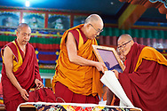 Namdol Phuntsok (best results at Geshema examination) from Kopan Nunnery after reading out a citation of gratitude to His Holiness and presented him with a framed copy illustrated and printed in traditional ornamental style of gold on blue Some of the nuns after receiving their Geshe-ma degree at Drepung Lachi Monastery in Mundgod, Karnataka, India on December 22, 2016