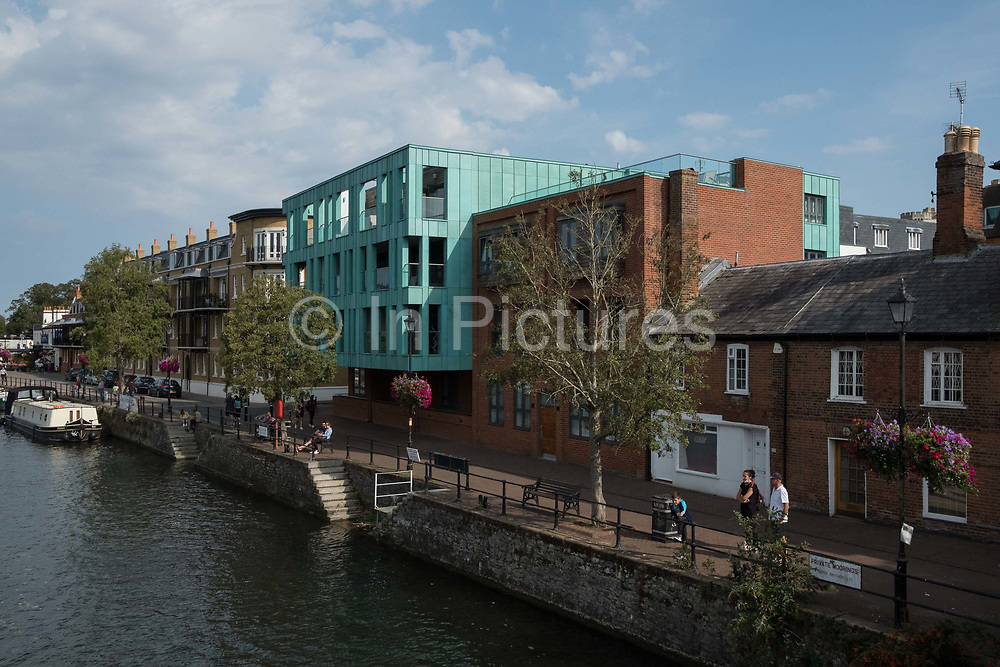 The Royal Windsor Quay building is pictured from Eton Bridge on 19 September 2020 in Windsor, United Kingdom. The 2010 red brick and pre-oxidised green copper residential building was designed by architects Lewandowski Willcox and is owned by the Hadley Property Group.