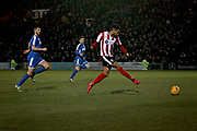 Lincoln City forward Matt Green scores to put  Lincoln 2-1 up during the EFL Sky Bet League 2 match between Lincoln City and Notts County at Sincil Bank, Lincoln, United Kingdom on 13 January 2018. Photo by Nigel Cole.