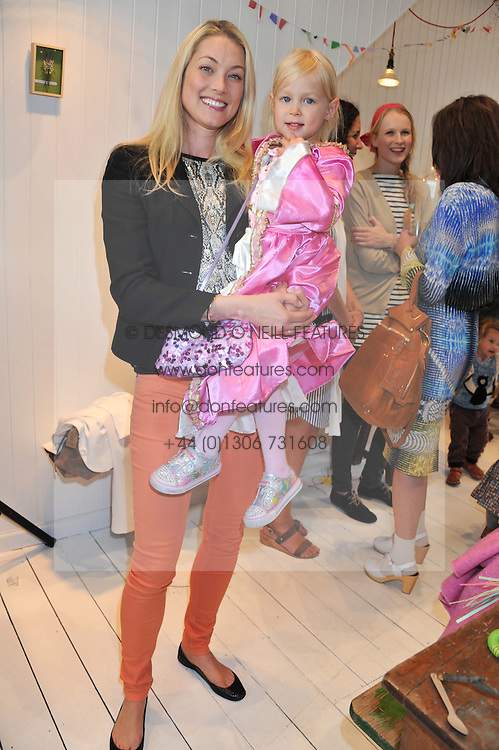 HEIDI BISHOP and her daughter SKYE at the launch of the Natalia Dress, inspired by Natalia Vodianova to benefit her Naked Heart Foundation held at Caramel Baby&Child, 77 Ledbury Road, London W11 on 16th May 2012.