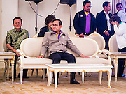 10 JANUARY 2015 - BANGKOK, THAILAND: General PRAYUTH CHAN-OCHA, the Prime Minister of Thailand, waits for a cultural performance to start during National Children's Day celebrations at Government House in Bangkok. National Children's Day falls on the second Saturday of the year. Thai government agencies sponsor child friendly events and the military usually opens army bases to children, who come to play on tanks and artillery pieces. This year Thai Prime Minister General Prayuth Chan-ocha, hosted several events at Government House, the Prime Minister's office.    PHOTO BY JACK KURTZ