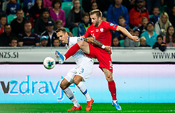 Jure Balkovec of Slovenia vs Jakub Błaszczykowski of Poland during the 2020 UEFA European Championships group G qualifying match between Slovenia and Poland at SRC Stozice on September 6, 2019 in Ljubljana, Slovenia. Photo by Vid Ponikvar / Sportida