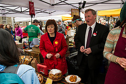Pictured: Sarah Boyack and Alex Rowley visited and helped out at the Knights Kitchen stall run by Jenna Sankiniemi and Luki Janz<br /> <br /> Scottish Labour deputy leader Alex Rowley was joined by the party's environment spokeswoman Sarah Boyack and party activists at a farmers' market in the Grassmarket, Edinburgh today. <br /> <br /> Ger Harley | EEm 1 April 2016
