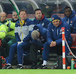 Arsenal Manager, Arsene Wenger looks at the floor as his team go on to lose 3 - 2 to Stoke City - Photo mandatory by-line: Dougie Allward/JMP - Mobile: 07966 386802 - 06/12/2014 - SPORT - Football - Stoke - Britannia Stadium - Stoke City v Arsenal - Barclays Premie League