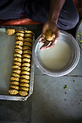 A boy moulding vegetable patties to fry Babu Shahi Bawarchi, New Delhi, India<br /> The famous but modest takeaway housed in the grounds of a shrine is famous for its biryani and whose owners ancestors served as chief cooks under the Moghul Emperor, Shah Jahan