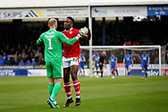 Barnsley goalkeeper Adam Davies (1)  and Barnsley defender Dimitri Cavare (12)  celebrate the first Barnsley goal during  the EFL Sky Bet League 1 match between Peterborough United and Barnsley at The Abax Stadium, Peterborough, England on 6 October 2018.