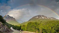 Cyclist under the rainbow, leaving Ushuaia, Patagonia, Argentina
