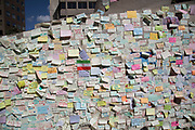A wall of post-it notes in which people from all over the World write messages of solidarity in tribute to the 7 people who were killed at London Bridge in the terrorist attack, London, England, United Kingdom. A memorial of flowers grew around the crime scene in remembrance to those who died. Londoners on their way to and from the area stop to refelct, read and pay respects at the shrine.