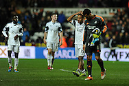 Swansea city's  Michel Vorm  and Wayne Routledge walk off dejected at end of match after drawing 1-1.  Barclays Premier league, Swansea city v Crystal Palace match at the Liberty Stadium in Swansea, South Wales on Sunday 2nd March 2014.<br /> pic by Andrew Orchard, Andrew Orchard sports photography.