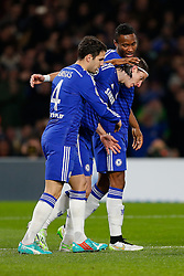 Cesc Fabregas of Chelsea celebrates with Filipe Luis and Mikel John Obi after scoring a goal from the penalty spot to make it 1-0 - Photo mandatory by-line: Rogan Thomson/JMP - 07966 386802 - 10/12/2014 - SPORT - FOOTBALL - London, England - Stamford Bridge - Sporting Clube de Portugal - UEFA Champions League Group G.