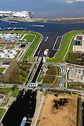 Nederland, Groningen, Delfzijl, 01-05-2013; zeesluis van het Eemskanaal gezien naar het zeehavenkanaal. Links de haven van Delfzijl, rechts het Chemiepark met Akzo-Nobel, de Eems in de achtergrond. <br /> De sluis maakt onderdeel uit van de vaarroute Lemmer-Delfzijl<br /> Sealock of the Eemskanaal, the port of Delfzijl.<br /> luchtfoto (toeslag op standard tarieven);<br /> aerial photo (additional fee required);<br /> copyright foto/photo Siebe Swart