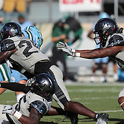 ORLANDO, FL - OCTOBER 24: Defensive back Richie Grant #27 of the Central Florida Knights tackles quarterback Michael Pratt #7 of the Tulane Green Wave at Bounce House-FBC Mortgage Field on October 24, 2020 in Orlando, Florida. (Photo by Alex Menendez/Getty Images) *** Local Caption *** Richie Grant; Michael Pratt