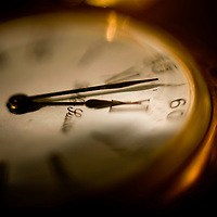 pocket watch at two minutes to midnight, time is counting down and running out.
