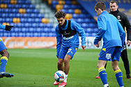 AFC Wimbledon midfielder Ayoub Assal (17) and AFC Wimbledon defender Jack Currie (26) warming up prior to kick off during the EFL Sky Bet League 1 match between AFC Wimbledon and Lincoln City at Plough Lane, London, United Kingdom on 2 January 2021.