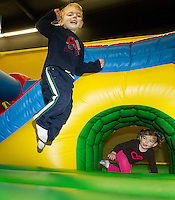 """Jasper and Rowan Sottak happily jump during the first annual """"Jump-a-thon"""" at Jump 'N Joy on Sunday to benefit the 2012 WLNH Children's Auction.  (Karen Bobotas/for the Laconia Daily Sun)"""