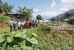 17 September 2018, Kavre district, Nepal: Maiya Devi Tiwari (centre), chair of the collection centre in Maidan, and her fellow community members receive Lutheran World Federation general secretary Rev. Dr Martin Junge. In the community of Maidan, villagers have started to practice semi-commercial vegetable farming, through support from the LWF World Service programme's Post-Earthquake Rehabilitation and Livelihood Recovery Project. Through a collection centre, villagers gather what surplus they have, and bring it collectively to the market in the nearby town of Kuntabesi.