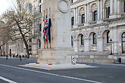 The Cenotaph on Whitehall under Coronavirus on 23rd March 2020 in London, England, United Kingdom. Following government advice most people are staying at home leaving the streets quiet, empty and eerie. Coronavirus or Covid-19 is a new respiratory illness that has not previously been seen in humans. While much or Europe has been placed into lockdown, the UK government has announced more stringent rules as part of their long term strategy, and in particular social distancing.