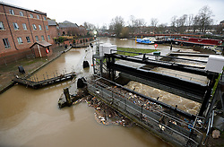 © Licensed to London News Pictures. 03/01/2016. York, UK. Water pours into the Foss Basin close to the Foss Barrier in York. Photo credit : Anna Gowthorpe/LNP