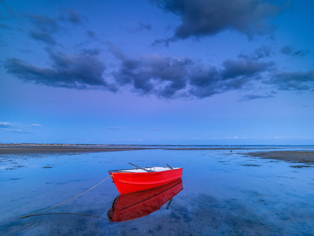 Lone orange rowboat moored at low tide, sand patterns & reflections, Provincetown Harbor, MA
