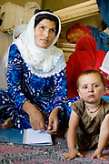 Balkh province Afghanistan. Samarkand-Dion. A mother attending adult education class.