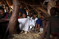 Alemenesh Bere, 11, and Manale Bihone, 23, sit together during their marriage celebration in the Yeterater Miriam village outside of Bahir Dar, Amhara Region, Ethiopia on May 26, 2007. They had never met before their marriage. It was the groom's father to arrange the wedding after hearing from fellow farmers that this girl would be a good wife. Because many married adolescents are pulled out of school at an early age, they may be unfamiliar with basic reproductive health issues, including the risk of HIV. Married adolescents often face familial and societal expectations to have children as soon as they are married. Even if contraceptive services are available, married adolescent girls may lack the power to use them, aggravating the risks of maternal mortality and morbidity for pregnant adolescents.