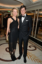 JAKE WARREN and his wife ZOE at the 24th Cartier Racing Awards held at The Dorchester, Park Lane, London on 11th November 2014.