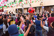 Children jump to catch toys thrown into the crowd during during El Dia de Reyes or Three Kings Day January 6, 2016 in San Miguel de Allende, Mexico. The traditional festival marks the culmination of the twelve days of Christmas and commemorates the three wise men who traveled from afar, bearing gifts for the infant baby Jesus.
