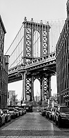 The Front Street icon of the Manhattan Bridge towers in front of the many residents in Brooklyn.