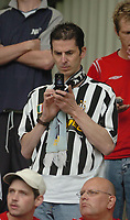 Photo: Leigh Quinnell.<br /> Notts County v Bury. Coca Cola League 2. 06/05/2006.<br /> A Notts County fan waits for news of other games on his phone.