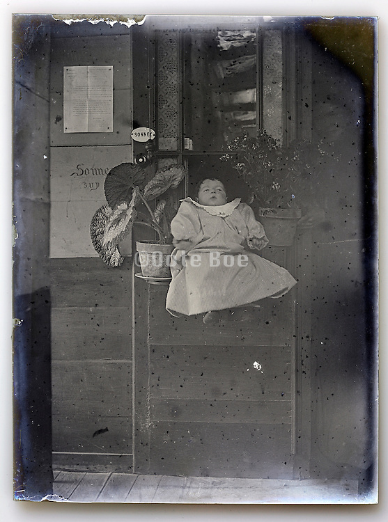 eroding glass plate with baby
