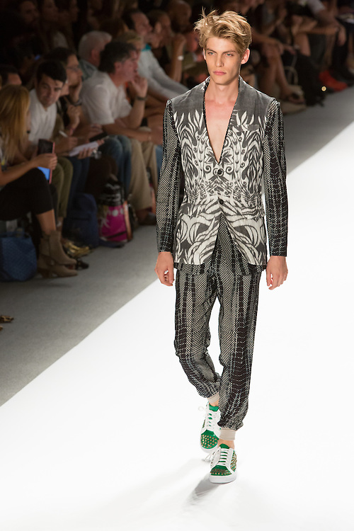 Men's open weave pants with elastic cuffed hems, matching top, and print vest. By Custo Barcelona at the Spring 2013 Fashion Week show in New York.